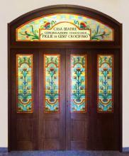 Stampa su vetro per porta con infisso in legno